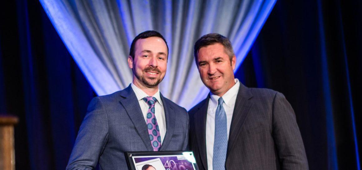 Caliber CEO Chris Loeffler accepts his 40 Under 40 award