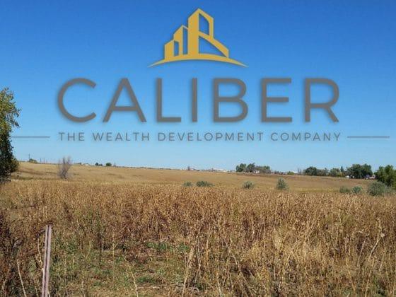 Caliber the Wealth Development Company Logo on Johnstown Backdrop of Landscape