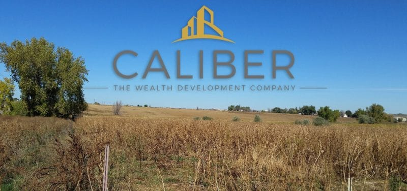 Caliber the Wealth Development Company Logo on Johnstown Backdrop of Landscape
