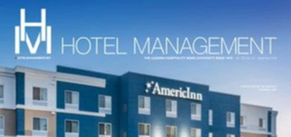 Hotel Management (HM) logo, with AmericInn building in the background