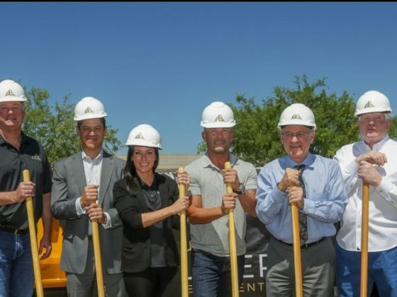 The Caliber construction team poses with shovels