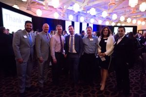 Caliber CEO Chris Loeffler poses with other guests of the event