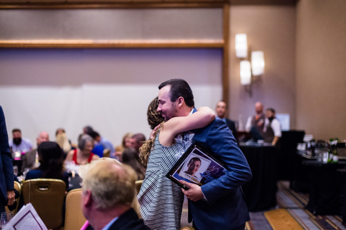 Caliber CEO Chris Loeffler hugs his wife