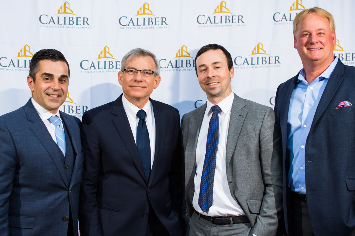 From right: Caliber's Roy Bad and Chris Loeffler pose with Congressman David Schweikert