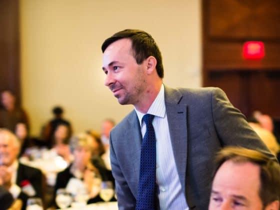 Caliber CEO Chris Loeffler speaks at a conference