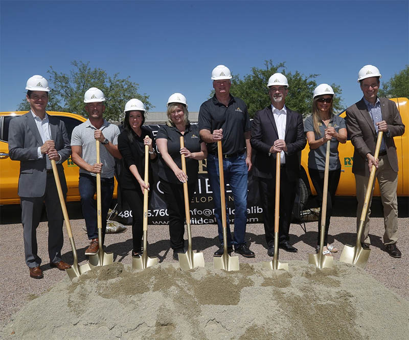 Groundbreaking in Tucson with Team in hard hats and with shovels