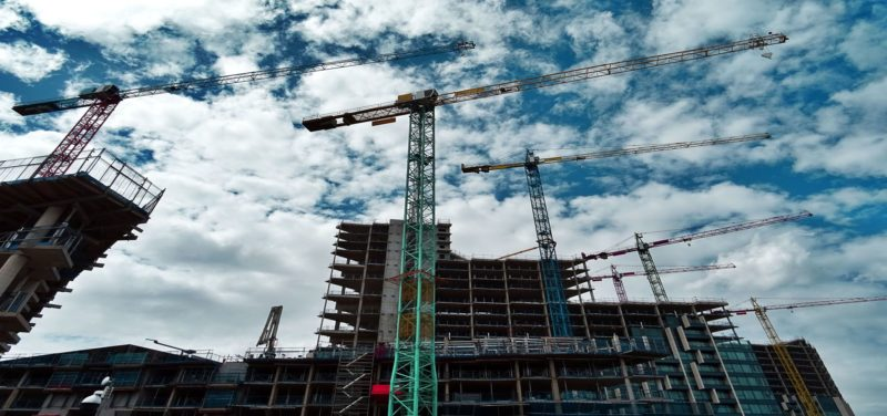 Construction raising a tower in a new development build strategy
