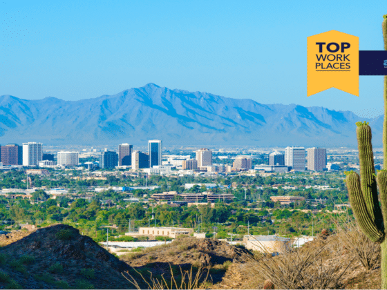 """A road sign overlooking downtown Phoenix from a mountain - """"AZ Top 2021 Workplaces"""""""