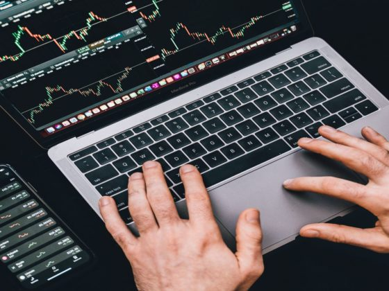 Preferred-equity-real-estate-investing- laptop-and-cellphone-with-market-trends-onscreen